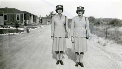 Black and white photograph of two unidentified women of the Canadian Women's Army Corps (CWAC), in uniform, at the Number Three Basic Training Centre in Kitchener, Ontario in 1943. In the ...