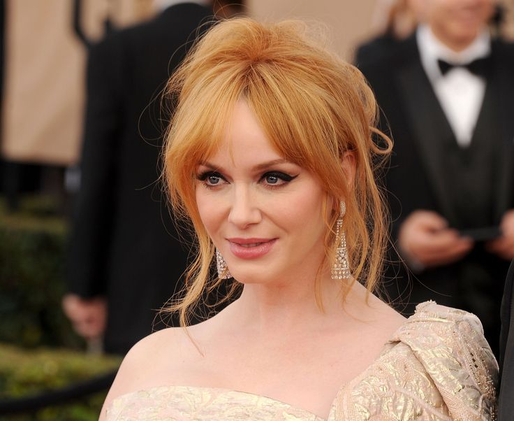 Actress Christina Hendricks turned heads with her sharp liquid eyeliner, flawless face and soft pink lips at the awards. #RedCarpetInspiration #Beauty #BeautyCrew