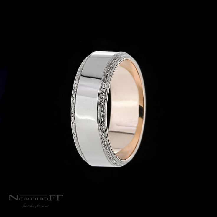 Meticulously handmade, this gentlemanly ring features hand engraved florentine and milgrain detail which ties in perfectly to the brides wedding and engagement ring, the rose gold lining adds a subtle warmth. http://nordhoffjewellery.com.au/