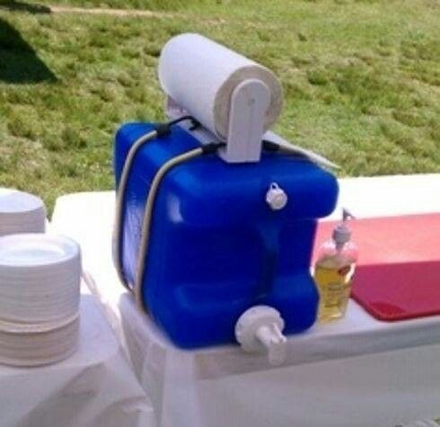 Laundry soap bottle+roll of paper towels+a couple of bungee cords=instant hand washing station! AWESOME IDEA!