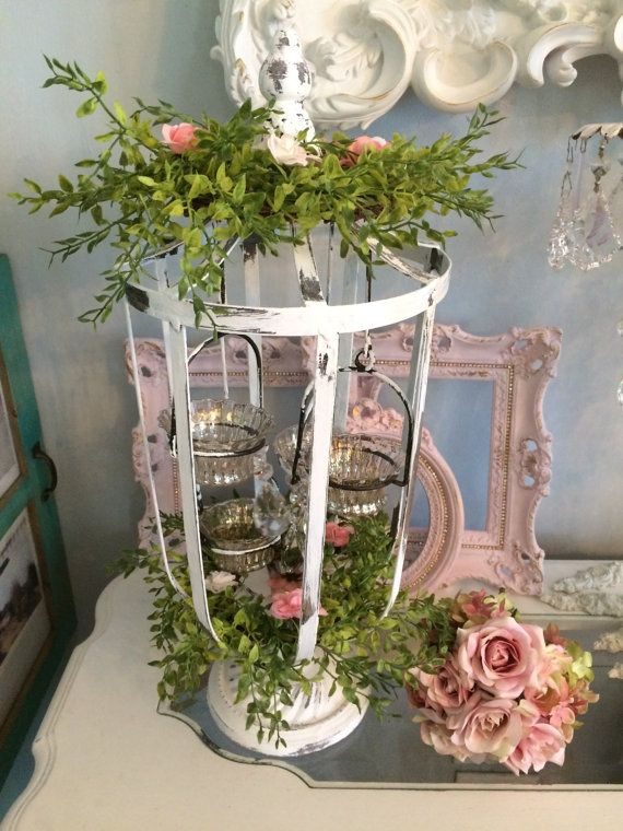 Wedding candle holder, tall lantern style with greens and mercury glass votive holders