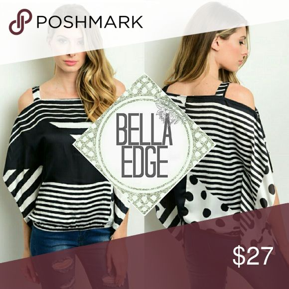 "Black white stripes dots cold shoulder top 100% POLYESTER This mixed print top features both striped and polka dot print all over, has exposed ""cold"" shoulders and batwing sleeves. Every shirt is similar to stock but unique Size small to large Bella Edge Boutique Tops Blouses"