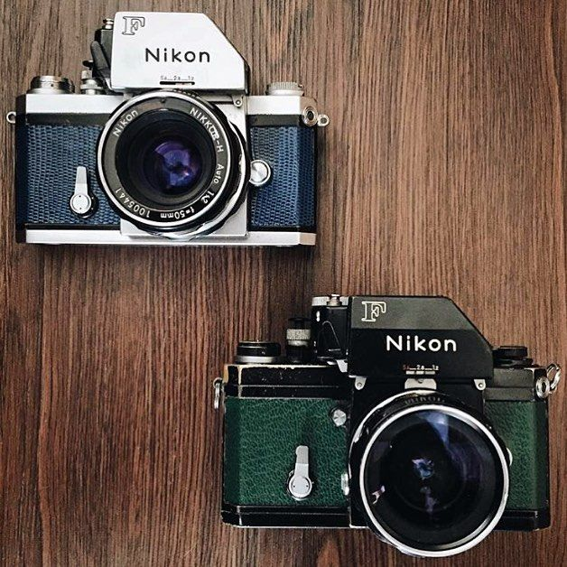 Two @completecamera exclusives for sale. $220 plus shipping. Serviced and ready to shoot. These gorgeous Nikon F 35mm SLR customs both feature FTn meter finders. The blue comes paired with a classic 50mm f2 Nikkor lens, and the green with a wide 28mm f3.5.