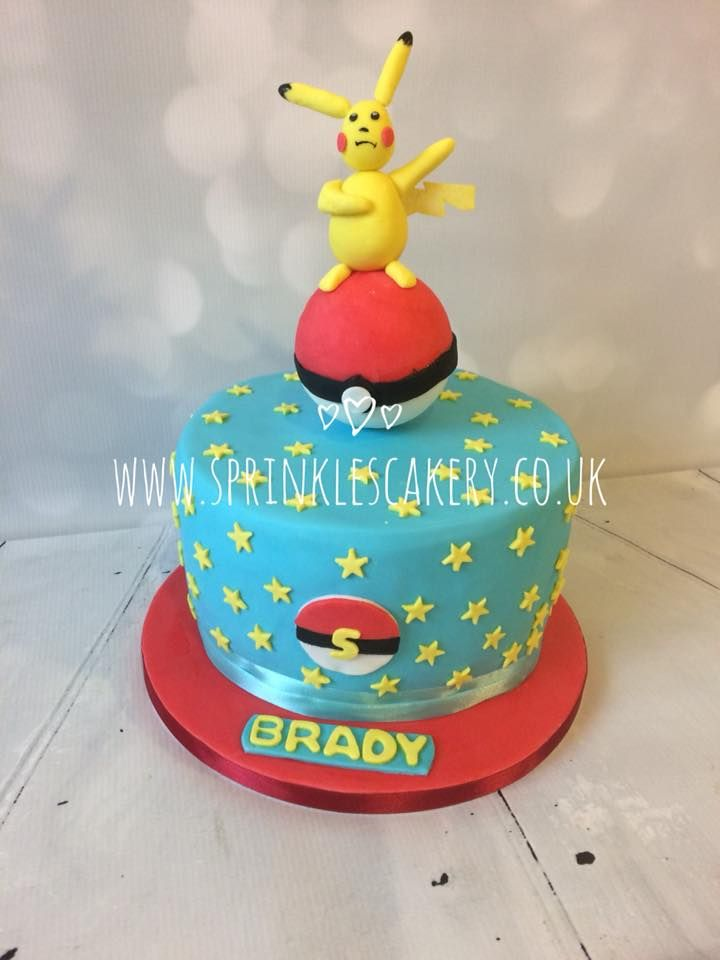A piñata style sweet filled  birthday cake with an edible handmade topper.