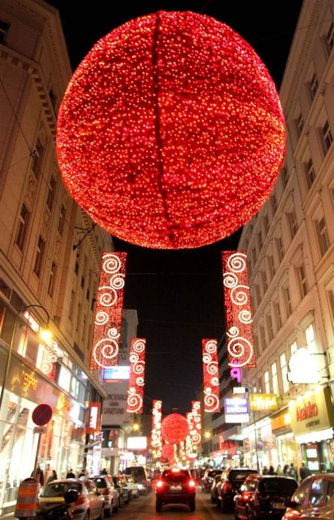 Christmas decorations glow in the old city of Vienna, Austria