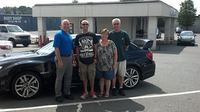 Folger Subaru Internet Sales Consultant Jim Gamble with Mr. Trent, his parents, and his 2012 Subaru WRX STI! They drove 6 hours from VA for this awesome car!