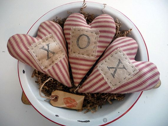 This is my original pattern. I used heavy red and white ticking fabric to make these 6 x 5 hearts. After stuffing, they were aged with walnut stain
