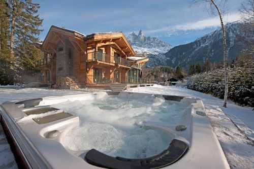 hot tub, snow, & ski lodge.