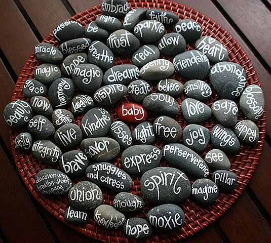 rocks painted with words of inspiration for a woman about to have a baby (names on the other side)