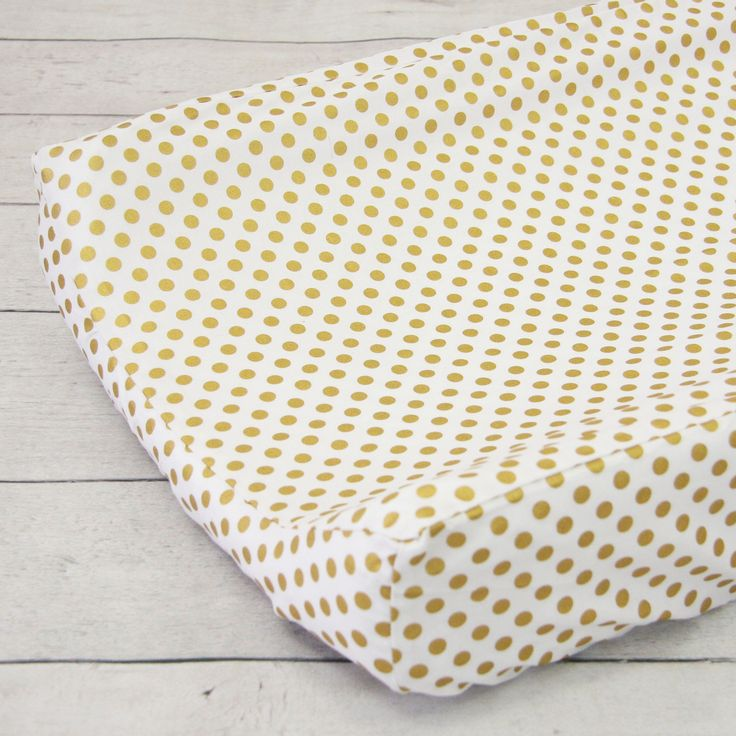 A Caden Lane Gold Dot Changing pad cover is perfect for a pink dresser. Pink and gold nursery inspiration :)