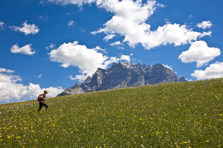 Female hiker is hiking through the grassland next to the mountain of Zugspitze (2962 m) on May 26, 2011 in Lermoos, Austria. (Photo by EyesWideOpen/Getty Images)