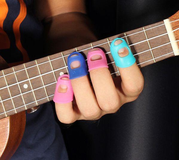 4 in 1 guitar fingertip protectors silicone finger guards for ukulele in 2019 good ideas. Black Bedroom Furniture Sets. Home Design Ideas