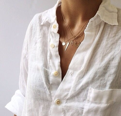 layered necklaces and linen shirt