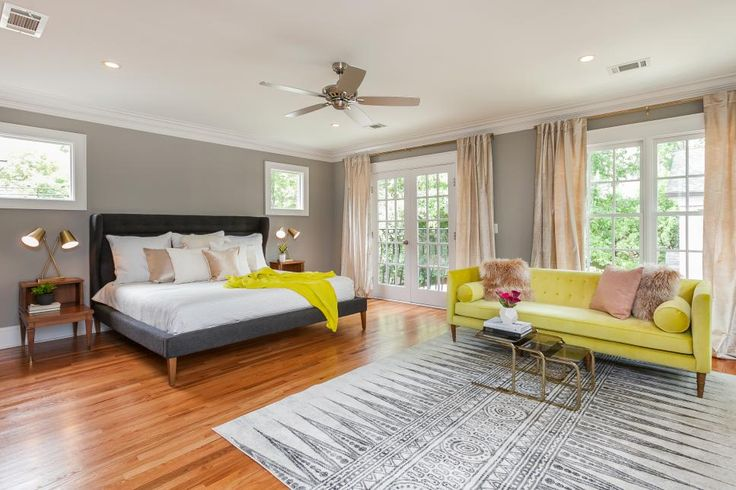 Can't fit a King size bed in your bedroom? No problem! Just turn your living room into your master bedroom. A matching throw and sofa are a nice touch. Image via Rooms Viewer   HGTV