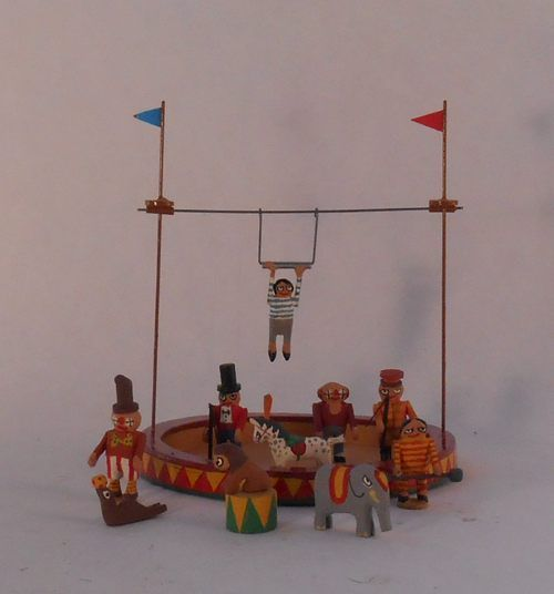 Chris Sturgess-Leif - haand painted wood and metal circus toy with Circus Ring, Collapsible Trapeze, Performing Seal, Horse, Lion & Elephant, Ring Master, Lion Tamer, 2 Clowns, Strongman and Trapeze Artist.