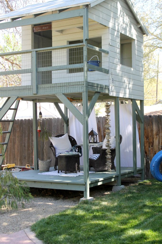 Adults will love this backyard play fort as much as the kiddos thanks to a shaded seated area with comfy wicker chairs.
