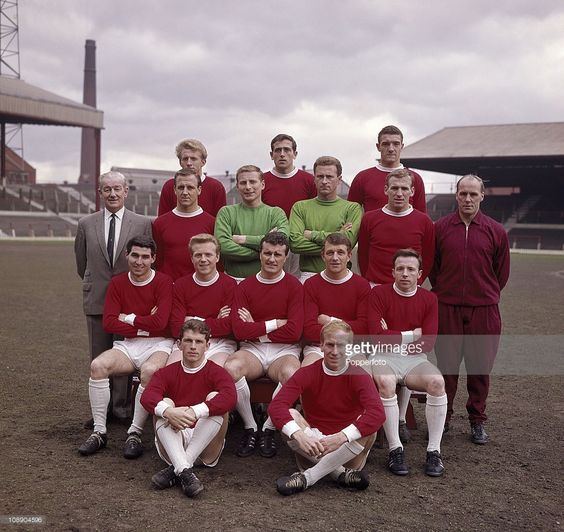 Manchester United at Old Trafford, Manchester prior to the FA Cup Final, April 1963. Back row, left to right: Denis Law, Shay Brennan and Bill Foulkes; standing, left to right: Ted Dalton (physiotherapist), Maurice Setters, David Gaskell, Harry Gregg, Pat Crerand and Jack Crompton (trainer); seated, left to right: Tony Dunne, Albert Quixall, Noel Cantwell, David Herd and Nobby Stiles; sitting on ground: Johnny Giles and Bobby Charlton.