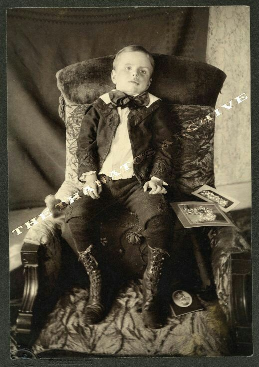 Postmortem of boy, propped in chair Looks to be dressed in his finest clothes.