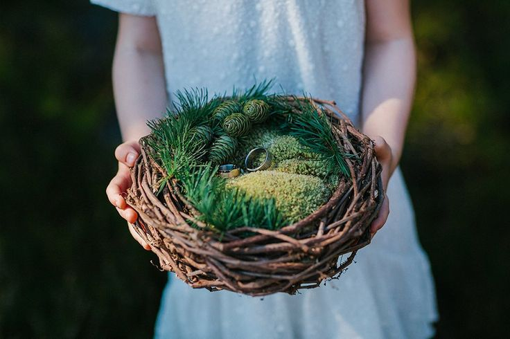Rustic ring bearer nest, made from twigs & moss - A forest green wedding colour scheme at an intimate outdoor coastal ceremony in Finland with DIY wedding dress, flowers and stationery