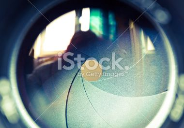 The diaphragm of a camera lens aperture. Royalty Free Stock Photo