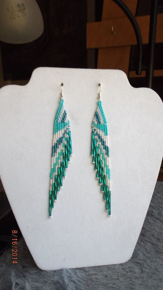 Beautiful Native American Beaded Turquoise, Silver,Teal Twisted Earring. With 1 inch long Twisted Teal Bugle Beads on them. They are 5 1/2