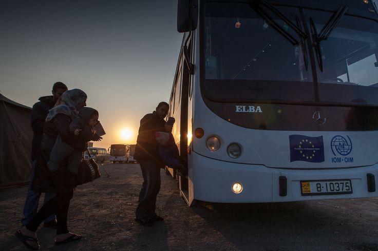 Migrants boarding the bus headed towards the processing center in Amman, Jordan.