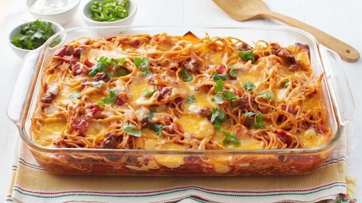This easy, family friendly casserole, dotted with melty pockets of cheese, proves that tacos and spaghetti are a match made in heaven.