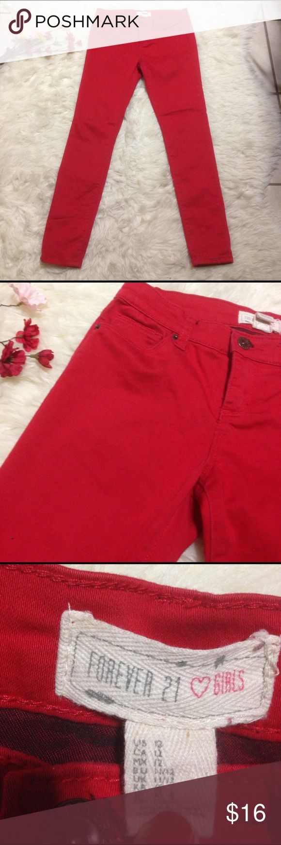 """Forever 21 Girls Red Skinny Pants Size 12 Soft and comfy. Stretch fabric. 4 pockets and can be belted. Beautiful vibrant red color. Amazing condition. Length 33"""" - Inseam 24"""" - Waist across laying flat 13.5"""" Forever 21 Pants Skinny"""