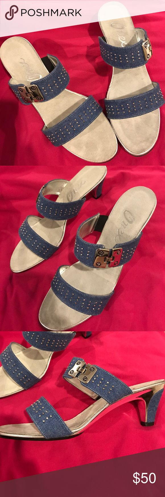 """Onex Denim Ceasars Heels So cute!  Perfect for this season's Denim trend!!  These shoes have Denim straps with silver hardware and studs. They have a 2 1/2"""" Denim heel. Brand new. Comes with box. Onex Shoes Heels"""