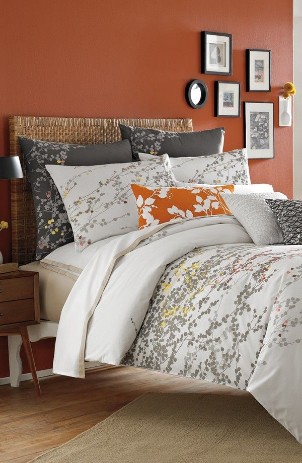 Autumn-Inspired Bedrooms Worth Falling For | Canvas: a blog by Saatchi Art. Autumn-hued accent wallsin burnt orange or rust are an appealing way to add colorto your rooms, and provide an interesting backdrop for small art and black and white photography.