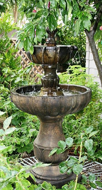 I love fountains...they make your garden sound so peaceful.