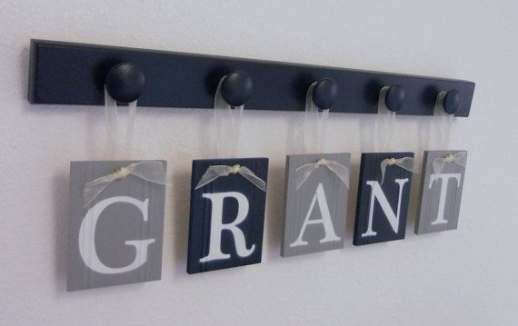 Navy Blue and Gray Nursery Wall Set includes Baby Boy Name GRANT and 5 Wooden Pegs Navy via Etsy. Hang under white shelf.