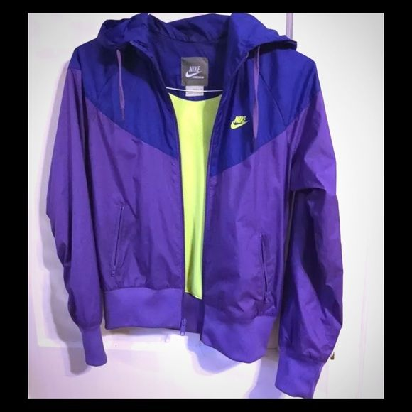 Nike windbreaker jacket for women Amazingly stylish Nike women's windbreaker jacket in purple and neon green. Has ear phone slits for your music and a hood in case of inclement weather.  Preowned and in great condition, please see my other listings for more! Nike Jackets & Coats