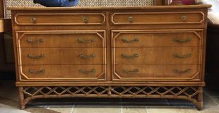 """Large Ficks Reed dresser with rattan details brings a tropical breeze into the bedroom. Light finish and faux bamboo brasses. Top quality construction. Made by Ficks Reed: circa 1970. 60"""" x 20"""" x 33"""" tall."""