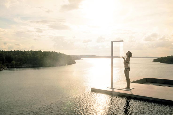 The outdoor shower from Tribù is elegantly designed in straight lines and has a separate tap for feet.