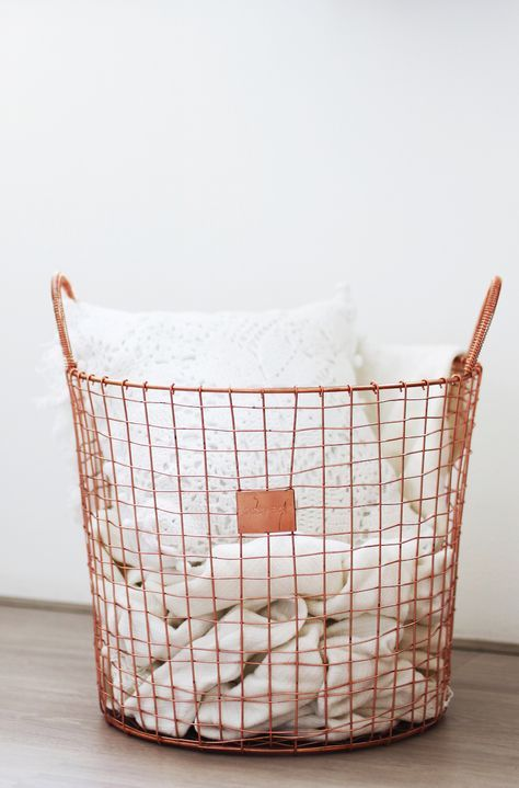 Copper wire basket. I'm so going to do this in our living room.