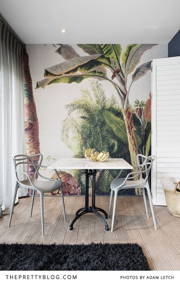 Wooden floors, palm tree wallpaper and a fluffy black rug - a beautiful yet eclectic room! https://www.theprettyblog.com/travel/magical-majeka-house/?utm_campaign=coschedule&utm_source=pinterest&utm_medium=The%20Pretty%20Blog&utm_content=Magical%20Majeka%20House