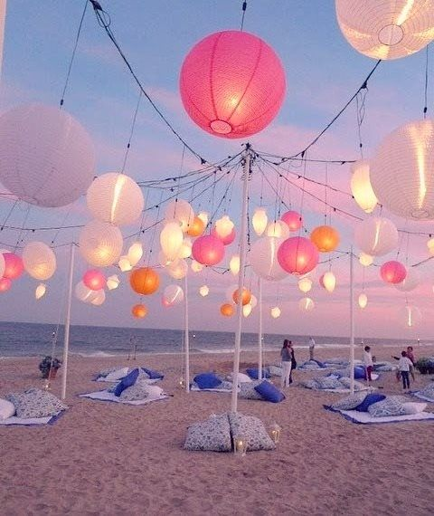 Stunning beach wedding...using paper lanterns....of course ;-)  Just imagine the atmosphere when it gets dark....lovely gentle lighting from the lanterns, with the sound of lapping waves in the background....simply perfect!