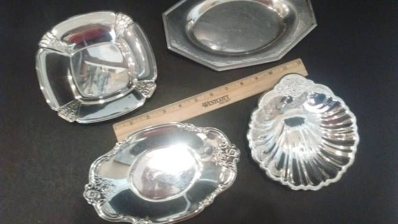 Jewelry dish next to the bed. Soap dish in the bath. Bon Bons before bed? Dont mind if I do. Deck out your boudoir or guest room with these baubles. For your consideration are four small vintage trays. These are selling as a lot.  -All are silverplate -2 are International Silver, noted in the details below. -Can be used as serving pieces, decor, soap dishes, candy dishes, jewelry dishes, coin catch-all trays and more  Shell -Silverplate -No company mark  Square -Bon bon dish by International…
