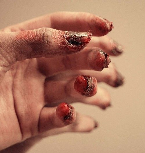 DIY Halloween Zombie Nails Tutorial. Photo and lots of other FX makeup frompsychosandra here.There isn't a real tutorial at psychosandra for these nails, but there is an excellent YouTube tutorial byfumsmusingshere.