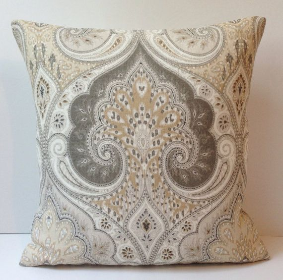 One decorative throw pillow. The front of the cover is a damask print in shades of beige, cream, taupe, gray and a touch of black. This is a linen home