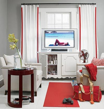 Den with white couches and a red yoga mat on the ground between them