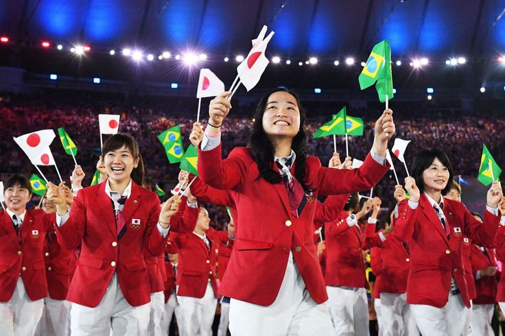 Japan represents: Members of the Japan delegation wave flags during the opening ceremony of the Rio 2016 Olympic Games at the Maracana stadium in Rio de Janeiro on Aug. 5, 2016