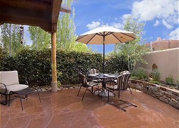 THIS HOME REQUIRES A 5 DAY MINIMUM BOOKING.     The Sangre de Cristo mountains offer a majestic backdrop Desirable location in Rosario Hill neighborhood. New, two story patio home close to the Plaza. Th...