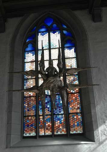 Stained glass window inside St. John's Church, Rothenburg, Germany.
