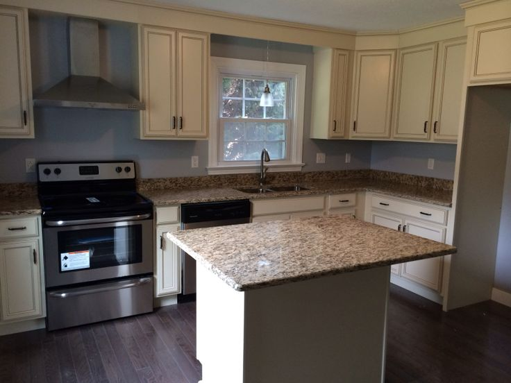 Ivory cabinets and beautiful granite countertops. Love this! Flip ...