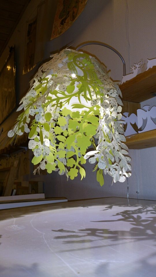 Green/white paper lampshade I, Naja Abelsen, cut from various papers. Similar can be ordered.