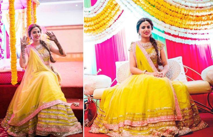 A yellow net lehenga with a gold border and a matching blouse by Manish Malhotra for Bride Ekta Bansal of WeddingSutra. Photos Courtesy- Anoop Padalkar Photography