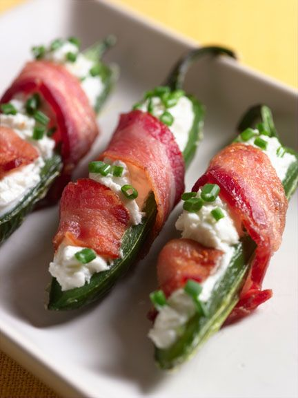 Goat Cheese Stuffed Jalapenos Wrapped in Bacon http://sweetpaprika.wordpress.com/archives/goat-cheese-stuffed-jalapenos-wrapped-in-bacon/