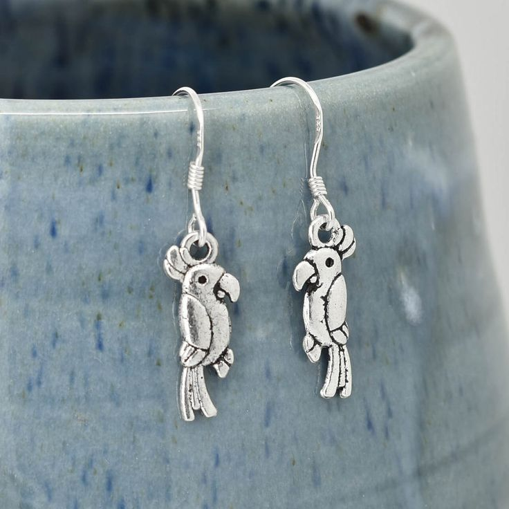 A personal favourite from my Etsy shop https://www.etsy.com/hk-en/listing/481724878/parrot-earrings-silver-earrings-parrot